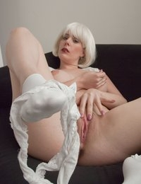 Today we're joined again by voluptuous California girl Heather Gates, with her platinum Hollywood wig and some sexy white undies.