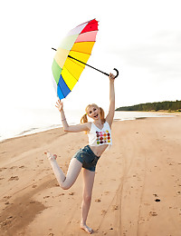 This petite teen blonde has her perfect little twat ready to have the sexiest beach walk in history.