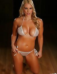 Busty blonde Alluring Vixen babe Deanna shows off her big boobs in her skimpy sexy silver string bikini