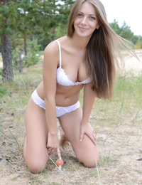 Admirable charmer with lovely tits taking off panties and showing naughty quim outdoor.