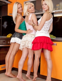 Thee beautiful blonde lesbian beauties stripping and posing in the nude in the kitchen.