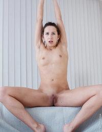 Skinny babe Janee pleasures herself using her nimble fingers