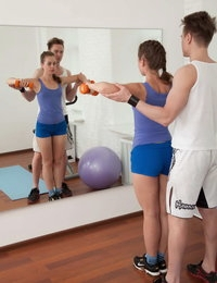 Amazing teenage cutie seduced by her nasty fitness coach