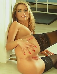 Tall blond stunner Kylie makes a reappearance enticing us into the bedroom beyond, where those long stockinged legs woul
