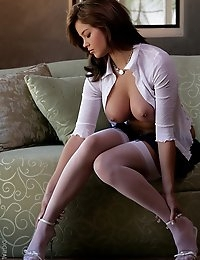 Christine in white thigh-highs and a short skirt