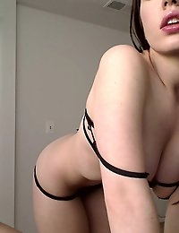 Adriana takes some webcam shots in some sexy black lingerie