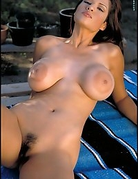 You absolutely must check out the free sample for this photo club. Of course we probably don't have to coax you with Kristine. With the most unique breasts on this site, along with a beautiful face, this Latina is one of our favorite Foxes.