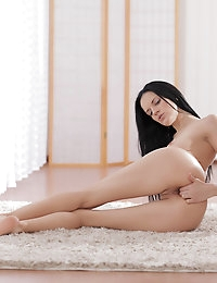 Raven haired Mia Michele takes her time heating up her super skinny body then rides her magic fingers towards ecstasy
