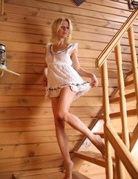 Slim beautiful blonde Yara enjoys posing solo