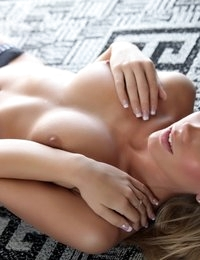 Taylor Faye posing sexy on the floor