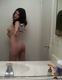 Horny slut takes selfshot pictures in the mirror