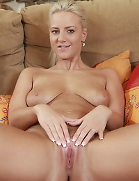 Nataly Cherie spreads her legs and fucks her pussy with her toy