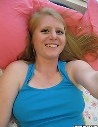 Redhead girlfriend shows off her natural tits in bed for her boyfriend