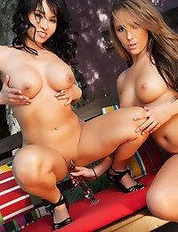 Lana Lopez and Ella Milano making sweet lesbian love on a park bench.