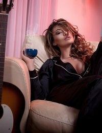 Barbara Belize posing in her black pajamas
