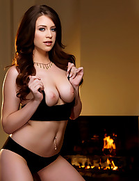 Delilah Blue teases her wet pussy while stripping behind the fireplace