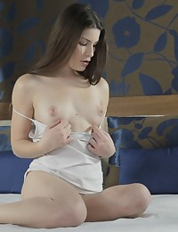 Watch brunette Xenia squeeze her upturned tits and then sink her magic fingers into her bald pussy in search of pleasure