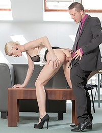 After the staff meeting wrapped up, Lynna Nilsson hung around to spend a little extra time getting close to her boss. They'd never crossed that line before, but Lynna made it clear with a caress of her finger-tips she felt like breaking all the rules. Rico dropped right down to hike up her dress and bury his face between her legs from behind. Rico spread Lynna open and licked her pussy, circling her clit and slipping his tongue inside her hole to taste her. Then he fucked her on the table, before moving over to fuck standing doggystyle by the window, where they risked it all to make their naughty office sex fantasy come true!