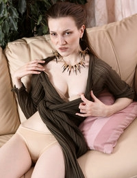 Elegant hottie Odina strips revealing her sexy body and juicy goodies