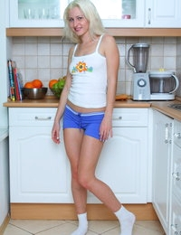 Teen blonde babe serves a piece of pussy salad in the kitchen like no other as she strips her clothes and teases you.