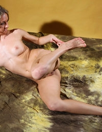 Flexible blonde stunner Ginny demonstrates the beauty of her curves