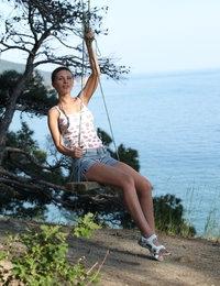 Fascinating model Cecelia strips by the sea revealing her lean body