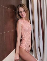 Lovely model Sabrina with fragile body opens legs to show her pink twat