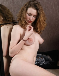 Curly and pale babe Celine showing her tight pussy
