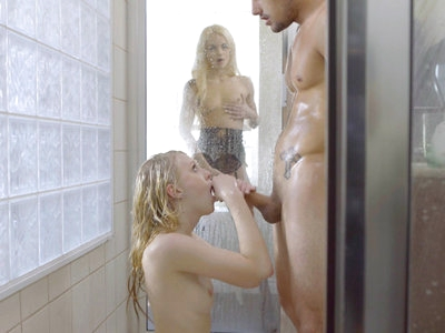 Tyler Nixon and Lily Rader are enjoying a sexy time in the shower, with Tyler using the slickness of the soap to really get Lily's motor running. Turning Lily around so that she faces the wall, Tyler rubs her soft skin down. Then he stands beneath the spray as Lily drops to her knees to deep throat his cock in a wet warm blowjob. It's only natural that he will return the favor, going down on his knees so that he can press his mouth into Lily's delightful twat.That's when Elsa Jean walks into the room. Decked out in lingerie, this blonde babe knows what she wants, and that is her two lovers in the shower. At first Elsa simply sits there caressing her clit and boobs as she watches Lily and Tyler in action. Once they notice Elsa, though, they are quick to invite her to join them.Strutting into the shower stall after she has peeled off her clothes, Elsa capture Tyler's lips in a long kiss before joining Lily so that they can deliver a double blowjob. Elsa is the first to finally get the D as she rises to her feet and lifts one leg so that Tyler can penetrate her greedy snatch while Lily continues suckling his balls. Tyler's blonde lover is so light that he can easily lift her while driving in and out of her fuck hole, and that's exactly what he does.Urging both girls up against the wall, Tyler takes the time to dive deep into each of their delightful pussies one after the other. Elsa is happy to drop to her knees after Tyler has had a taste so that she can fondle his balls and suck him off as he delivers a pussy pounding to Lily who remains up against the wall. When Tyler lays down on the shower floor, Elsa takes the opportunity to give a bouncing stiffie ride by straddling him and impaling her bare twat on his long fuck stick. Lily likes what she sees so much that she demands her turn next so that her landing strip snatch is filled to the brim. It's not long before both girls have been fully satisfied.Kneeling together once again, Elsa and Lily take turns giving Tyler 