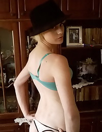 Skinny blonde girlfriend strips down to just her hat while her boyfriend takes pictures to share with us